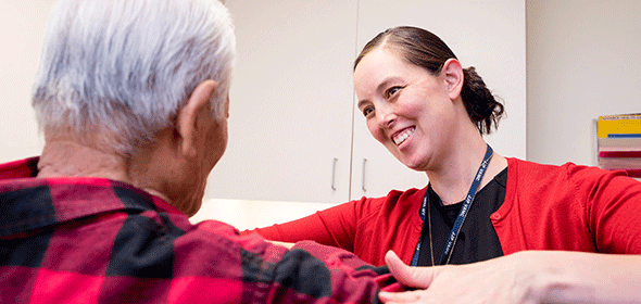 UCSF cancer geriatrics worker works with patient