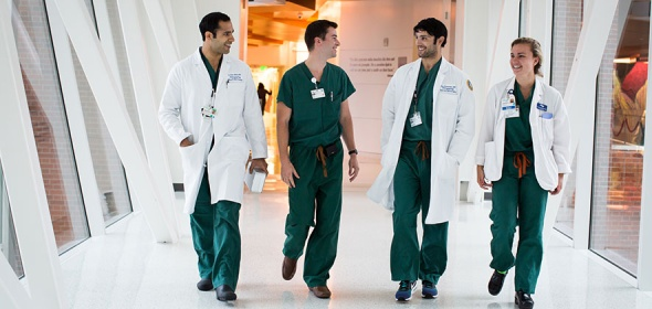 A team of doctors walks the halls of UCSF