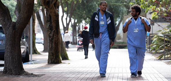 Medical students walk on UCSF Parnassus campus