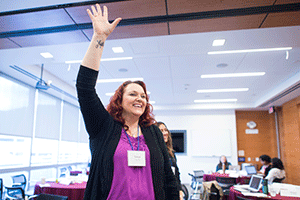 Healthforce Center leadership training participant raises hand
