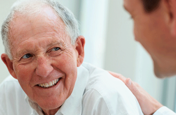 And older adult male works with a caregiver