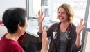Carol Lei, caregiver, discuss with Lena Driscoll, MSN, at UCSF Mission Bay.
