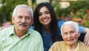 Home health worker smiles with elderly patients