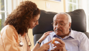 Community health worker interacts with patient